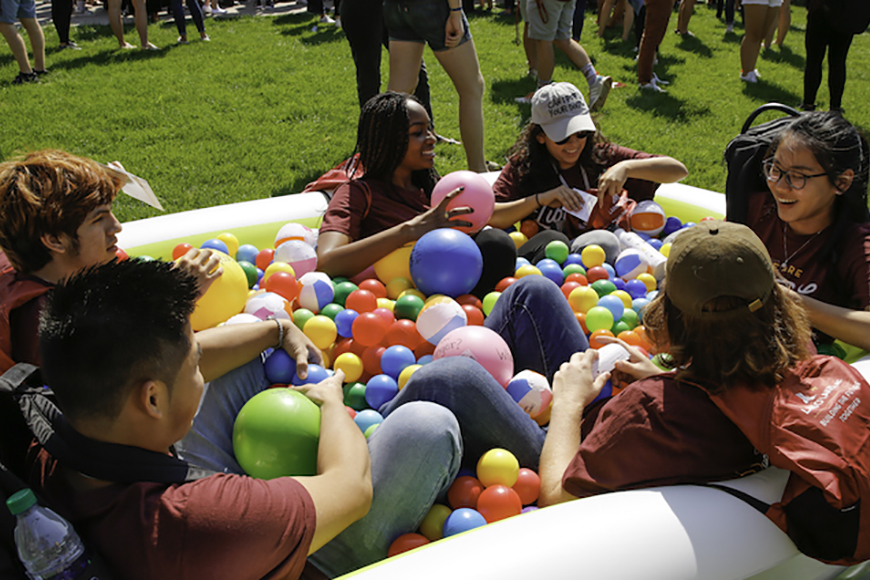 Students talking in ball pit
